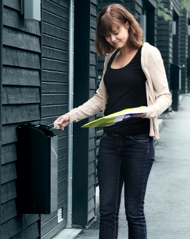 woman collecting letters from her mailbox