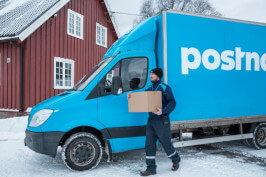 PostNord driver delivering package in Nordic snow climate